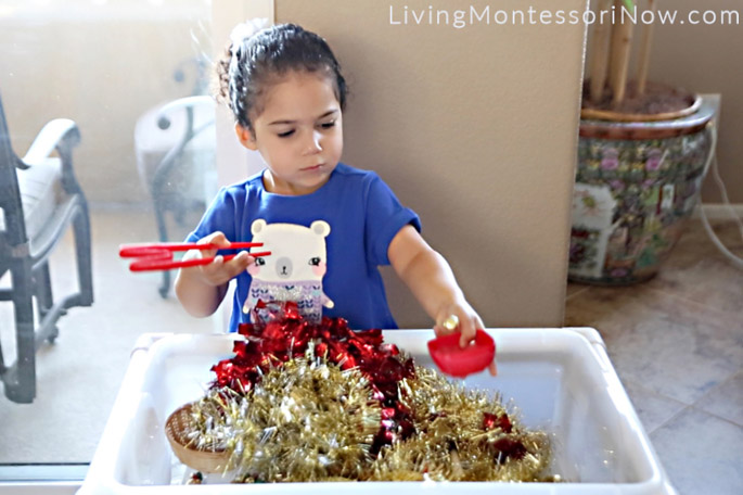 Making Music with Jingle Bells from Holiday Bell Sensory Bin