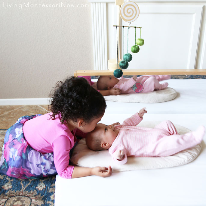 4-Year-Old and 10-Week-Old Sisters Having Fun Together with the Montessori Gobbi Mobile