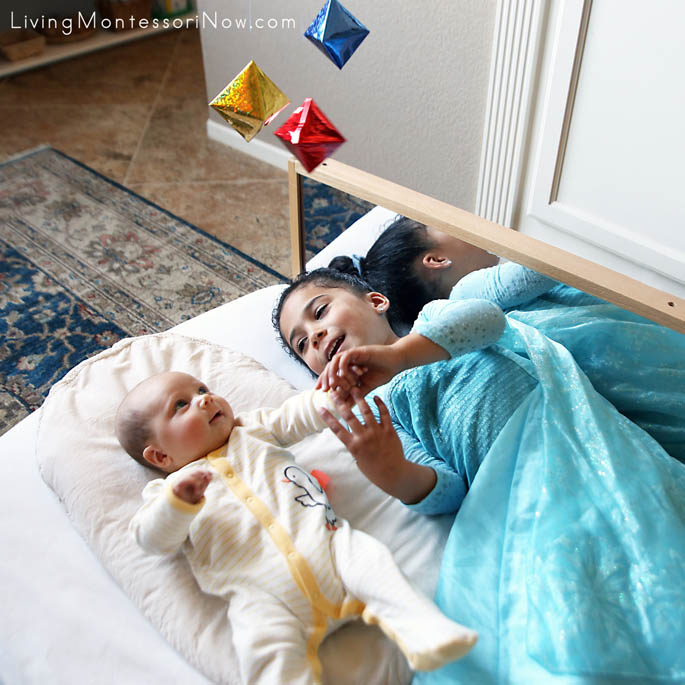 8-Week-Old and 4-Year-Old Sisters Having Fun Together with the Montessori Octahedron Mobile