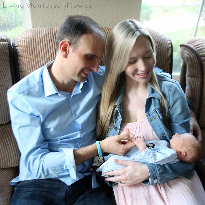 Proud Parents with 2-Day-Old Baby at Home