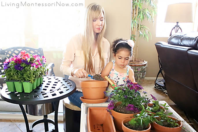 Adding Soil to Transplanted Plants in the DIY Sensory Table
