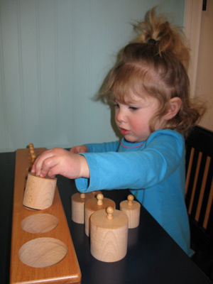 Using a Cylinder Block (Photo from Discovery Days and Montessori Moments)