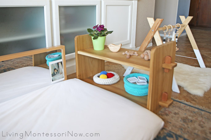 Baby Shelves Near Flloor Bed and Wooden Baby Gym