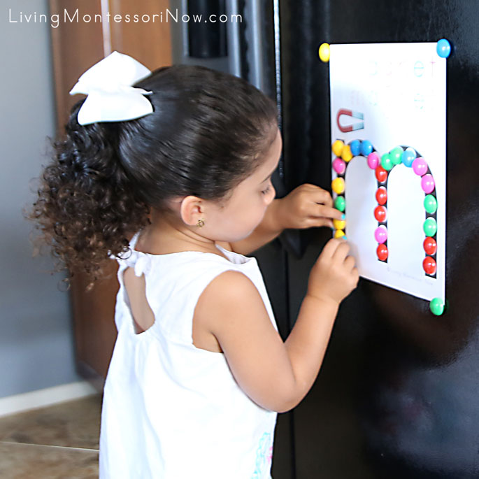 Placing Power Magnets on Do-a-Dot Letter M on Refrigerator