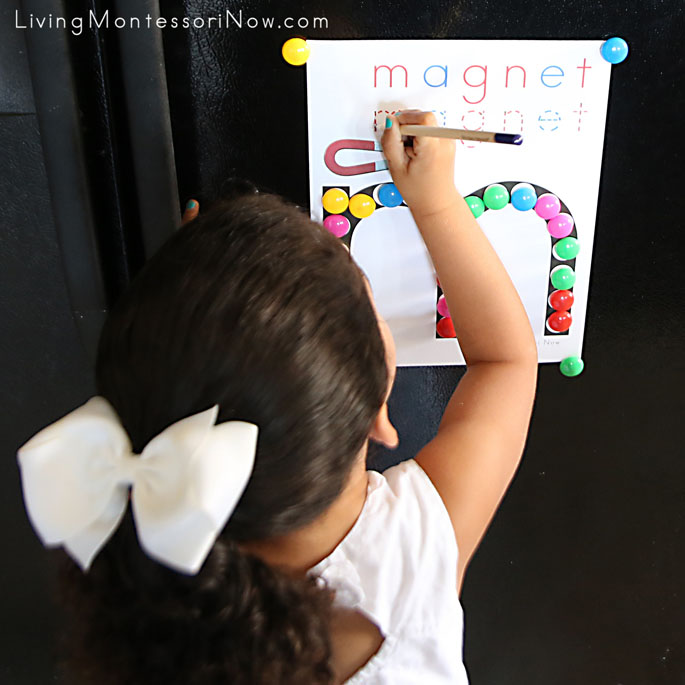 "Tracing Letters in the Word ""magnet"" on Refrigerator"