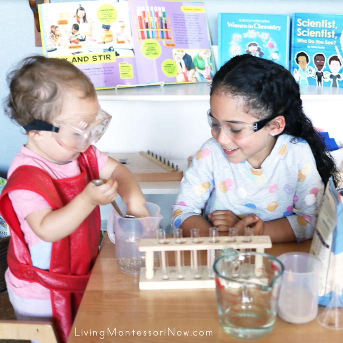 Sisters Working with Chemistry Mixtures (Sand and Water Mixture in Photo)