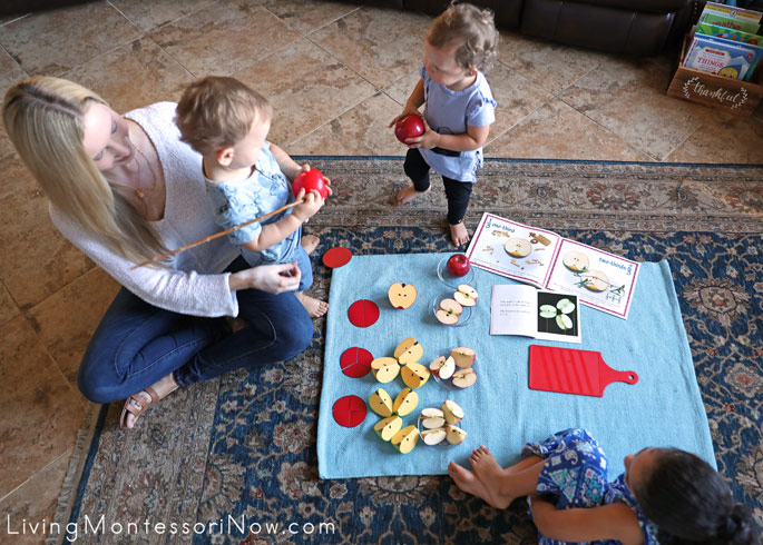 Toddlers Examining Whole and Half Apple Fractions