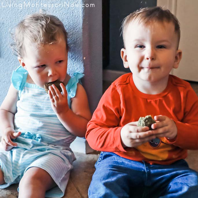 Toddlers Enjoying Sweet Spinach Muffins Together