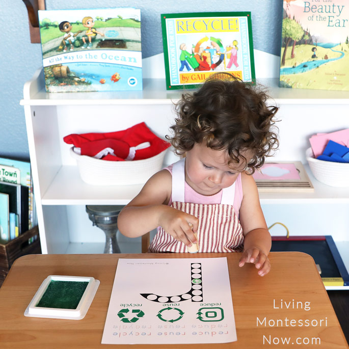 Concentrating on Using Recycle Stamp with Reduce, Reuse, Recycle Letter R Do-a-Dot Page