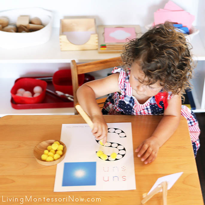 Concentrating on Using Toast Tongs to Transfer Pom Poms to the Sun Do-a-Dot Printable