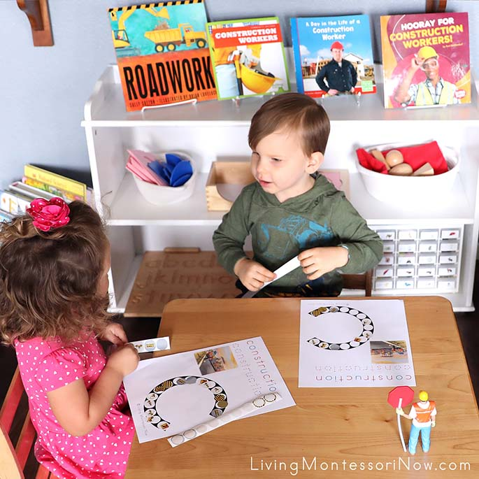 2-and-a-half-year-old Cousins Visiting and Working Together on Their Construction Do-a-Dot Pages