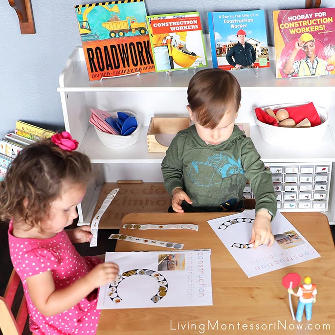 2-and-a-half-year-old Cousins Working Together on Their Construction Do-a-Dot Pages