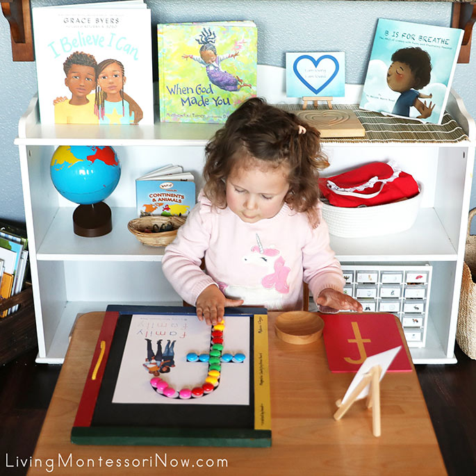 Admiring Her Magnet Work with F for Family Do-a-Dot Printable