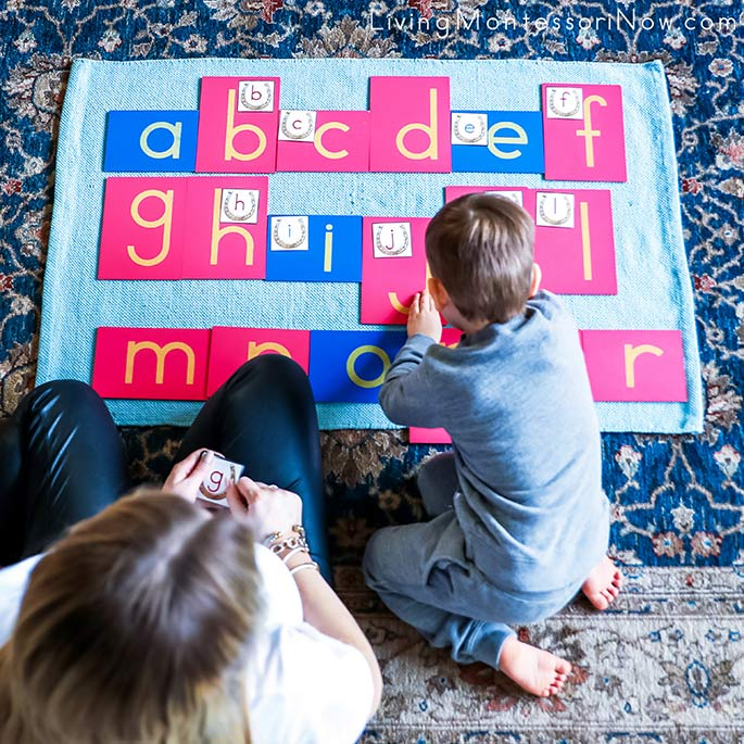 Matching Lucky Horseshoe Alphabet Cards to Sandpaper Letters